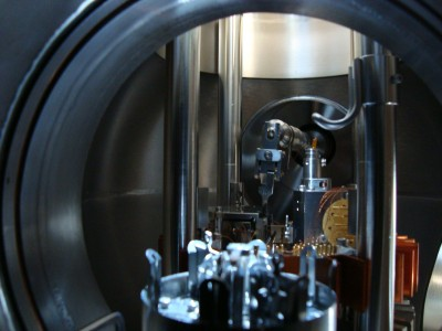 Internal view of UHV chamber with sample carousel in front and the AFM stage at the back - access to the chamber is only possible via manipulator