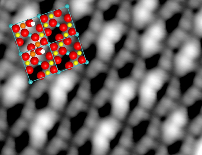 Fe3O4 with adsorbed water: Hydrogen seen by STM