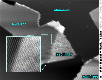 Single-layer NaCl(100) island with (111)-oriented rim