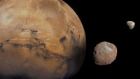 The planet Mars with its moons Phobos and Deimos