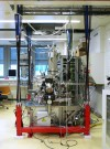 High-resolution microscope suspended for vibration isolation